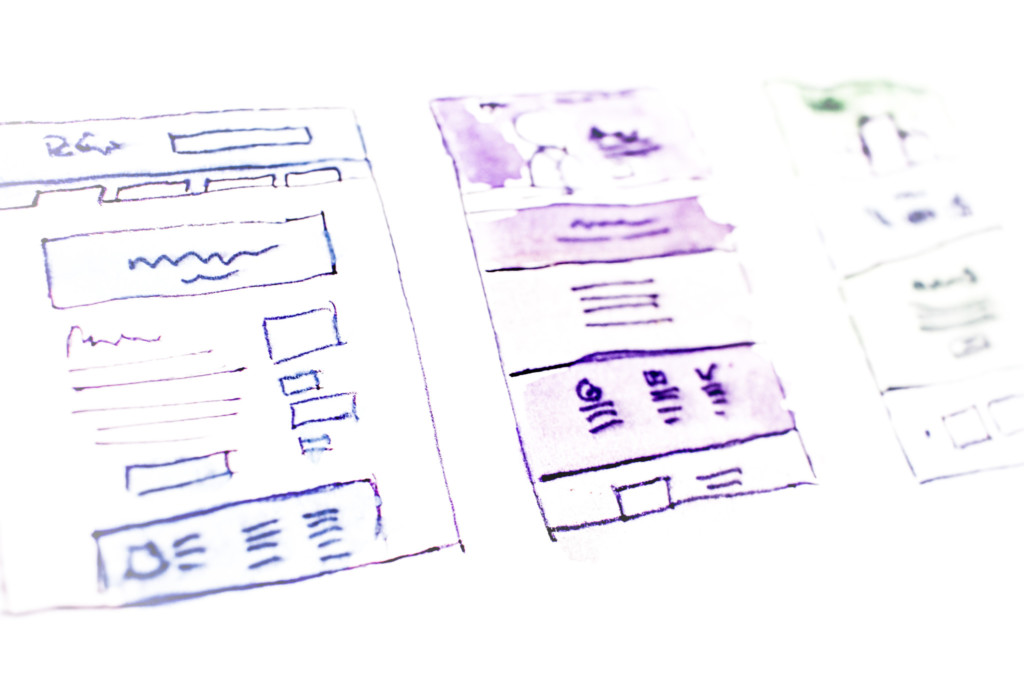 Photo of a series of sketched website wireframes